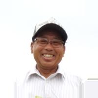 笑顔の百笑のたなか園主田中さん
